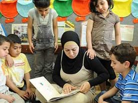 woman reading a book with children around her