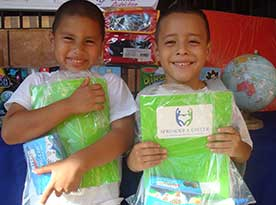 two boys holding packages