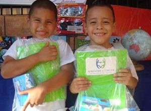 two boys holding up packages