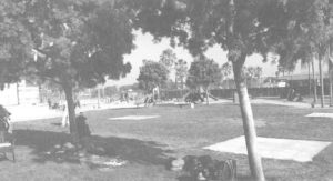 black and white image of field and playground