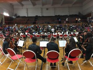Music cluster concert with students playing instruments